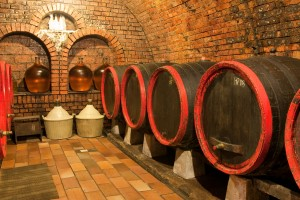 bigstock-wine-barrels-in-old-wine-cave-27147194